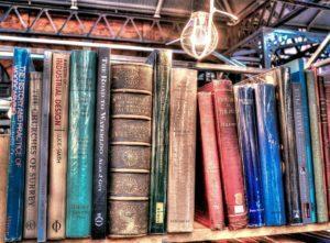 A bookshelf full of coloured books