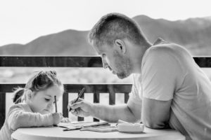A father and daughter colouring
