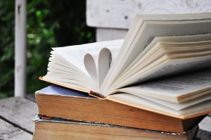 a book with pages forming a heart