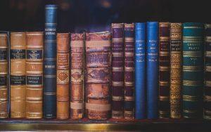 A bookshelf full of hardback books
