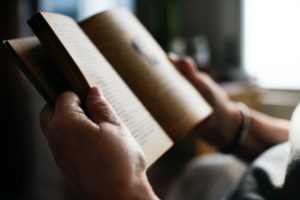 Close up of a man reading a book
