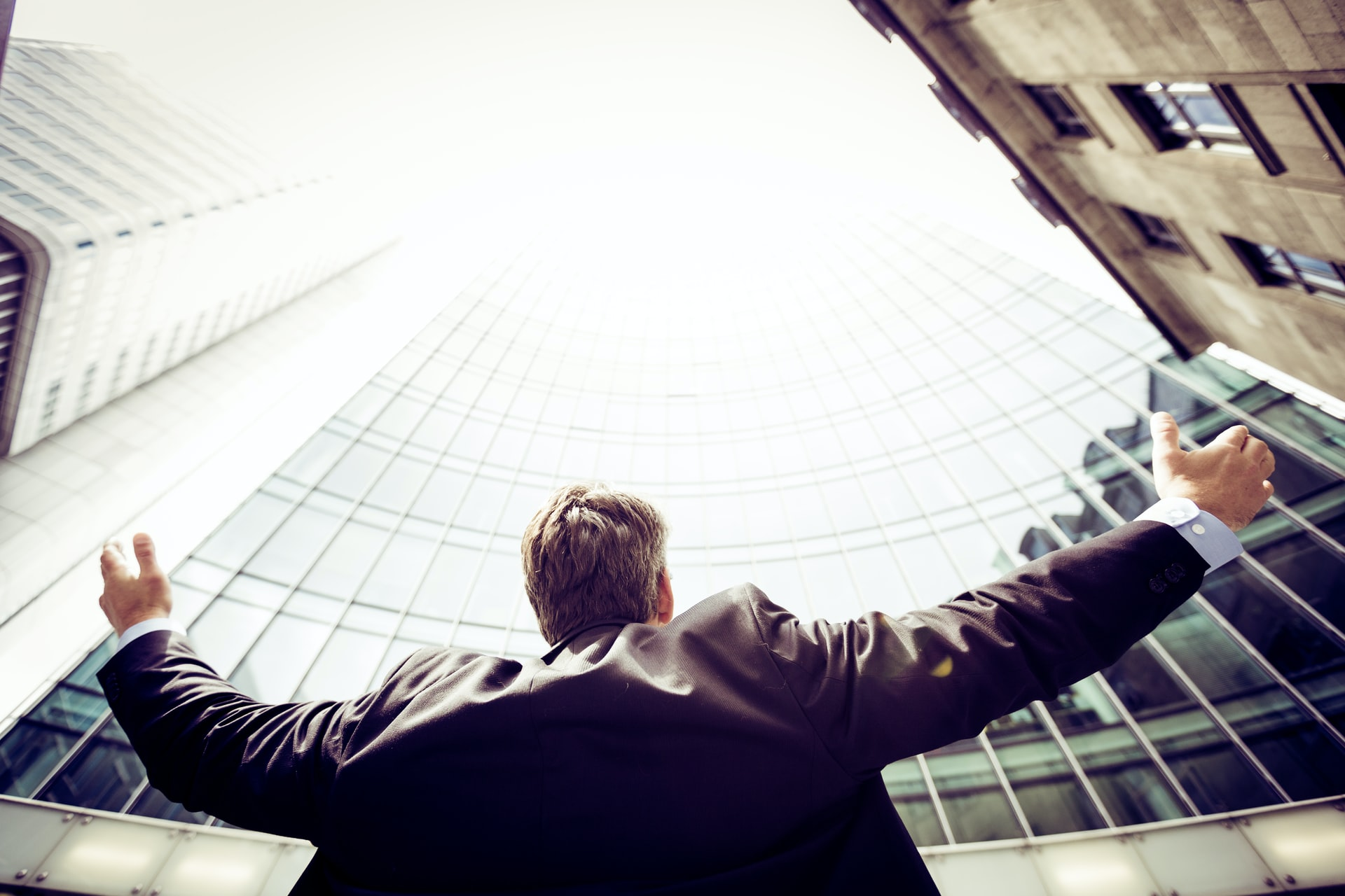 a businessman with his arms outstretched to symbolise using a print broker